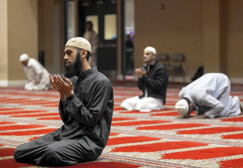 Muneeb Baig prays after sunset during the second day of Ramadan at the Islamic Society of Orange County in Garden Grove on Tuesday.