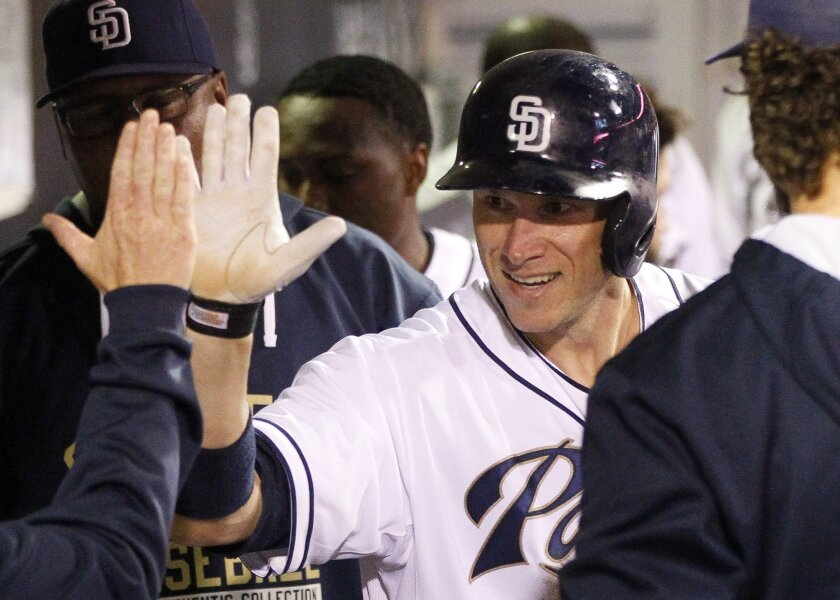 The Padres' Clint Barmes is congratulated in the dugout after he hit a home run in the eighth inning.