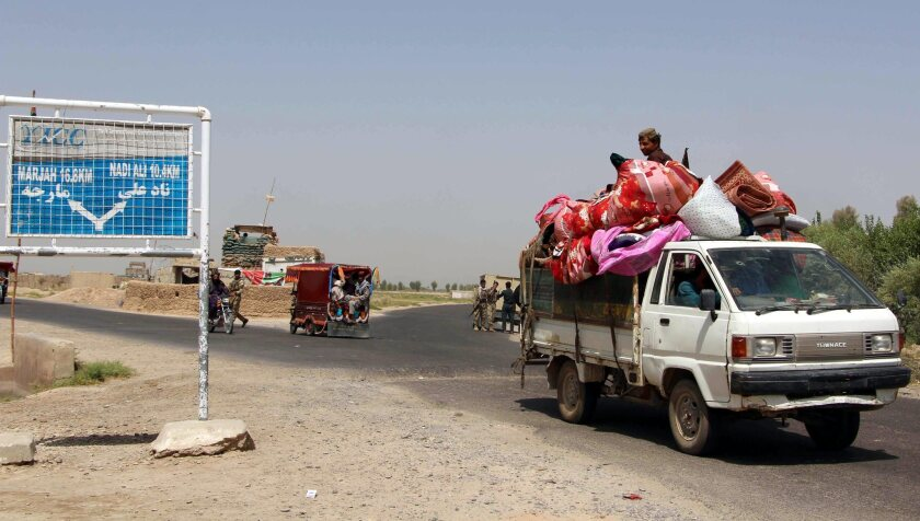 Families flee after clashes between the Afghan security forces and Taliban militants in the Nad Ali district of Helmand province on Aug. 1, 2016.