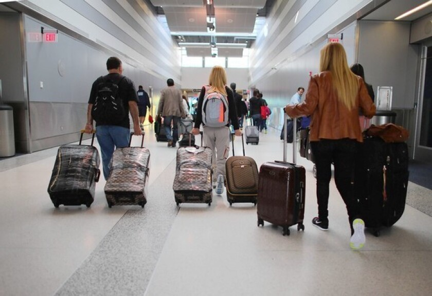 In the future, you can expect more airlines to offer special package deals based on your past preferences. The offers might include airline tickets bundled with onboard food, drinks and entertainment, all at a discount price. Above, travelers walk through Miami International Airport the day before Thanksgiving.