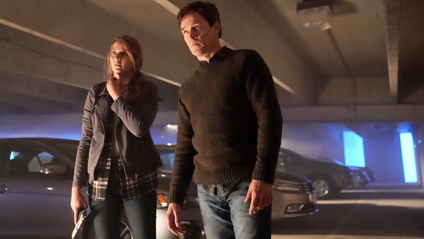 """Amy Acker and Stephen Moyer in """"The Gifted"""" on Fox."""