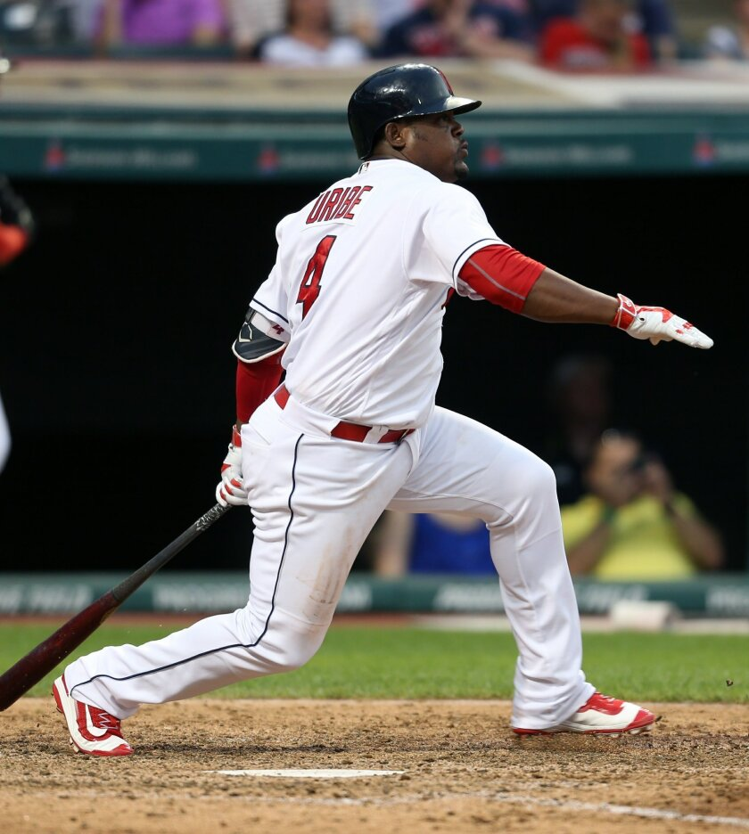 Cleveland Indians' Juan Uribe watches his RBI single off Texas Rangers relief pitcher Luke Jackson during the eighth inning of a baseball game Wednesday, June 1, 2016, in Cleveland. (AP Photo/Ron Schwane)