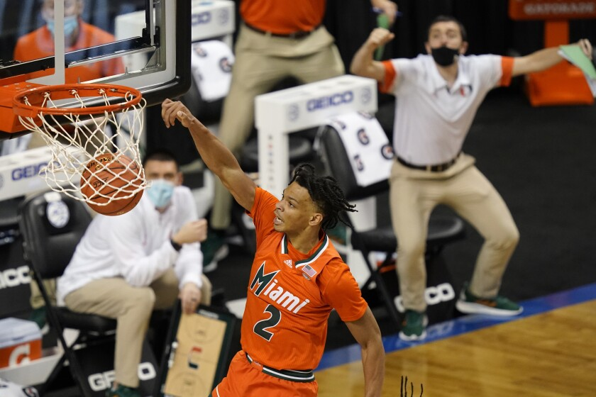 Miami guard Isaiah Wong (2) slams home a dunk during the second half an NCAA college basketball game against Pittsburgh in the first round of the Atlantic Coast Conference tournament in Greensboro, N.C., Tuesday, March 9, 2021. (AP Photo/Gerry Broome)