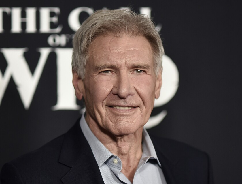 """FILE - Harrison Ford attends the premiere of """"The Call of the Wild"""" in Los Angeles on Feb. 13, 2020. Ford is taking a hiatus from filming """"Indiana Jones 5"""" after sustaining an injury on set. The 78-year-old was hurt rehearsing a fight scene, a spokesperson for the Walt Disney Co. said Wednesday. (Photo by Richard Shotwell/Invision/AP, File)"""