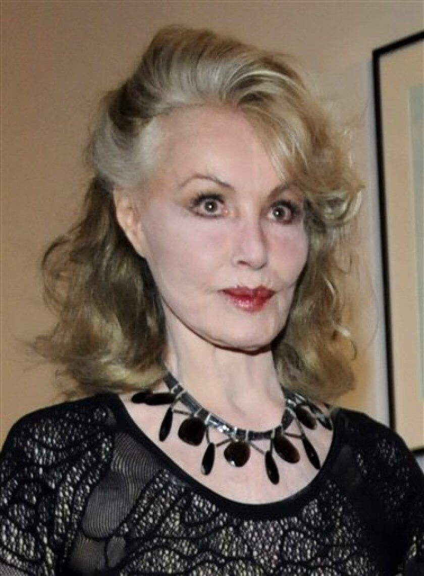 "In this May 2, 2009 file photo, Julie Newmar attends the opening night of ""Bettie Page: Heaven Bound"", a tribute to the late pin-up model, at World of Wonder Storefront Gallery in the Hollywood section of Los Angeles. (AP Photo/Robert Kenney, file)"