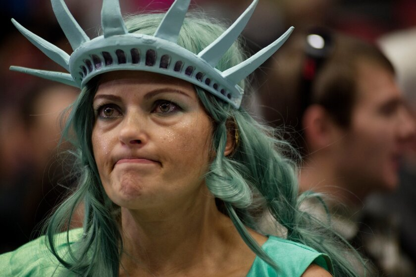 Mary Simcox of Portland, Mich., dressed as Lady Liberty before a Donald Trump campaign rally at the DeltaPlex in Grand Rapids, Mich., on Monday.