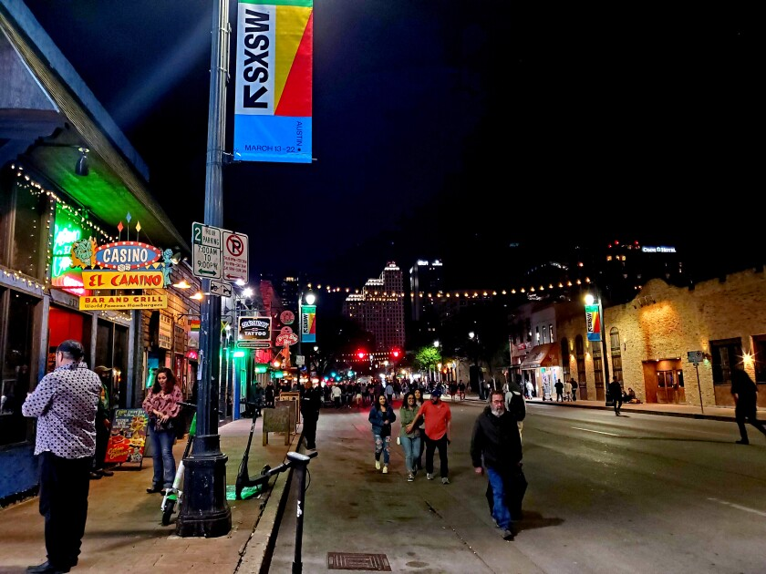 Even after Austin's mayor canceled the coming South by Southwest festival, some continued to visit Sixth Street downtown on Friday night.
