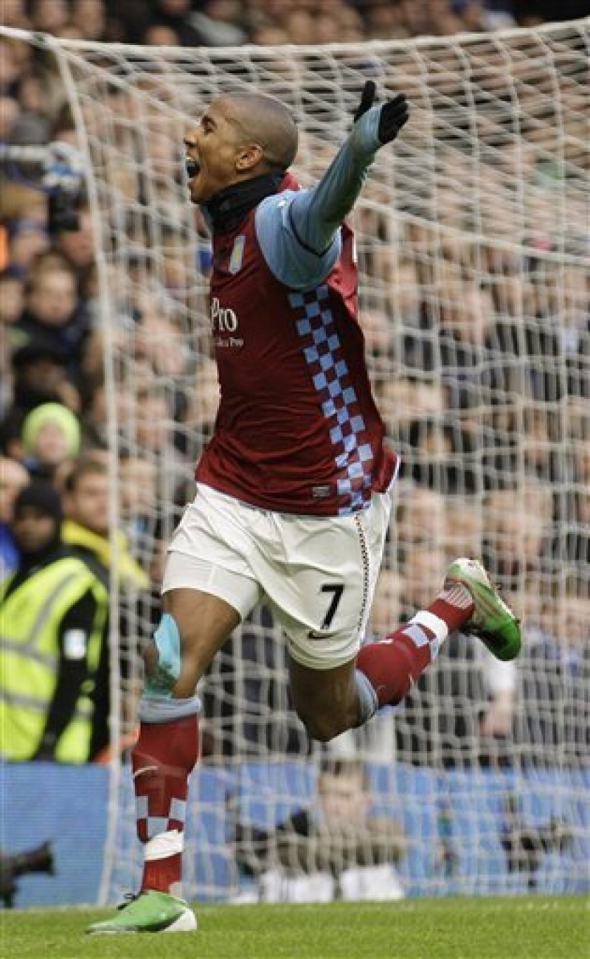 Aston Villa's Ashley Young celebrates his penalty goal against Chelsea during their English Premier League soccer match at Stamford Bridge, London, Sunday, Jan. 2, 2011. (AP Photo/Sang Tan) NO INTERNET/MOBILE USAGE WITHOUT FOOTBALL ASSOCIATION PREMIER LEAGUE (FAPL) LICENCE - CALL +44 (0)20 7864 9121 or EMAIL info@football-dataco.com FOR DETAILS