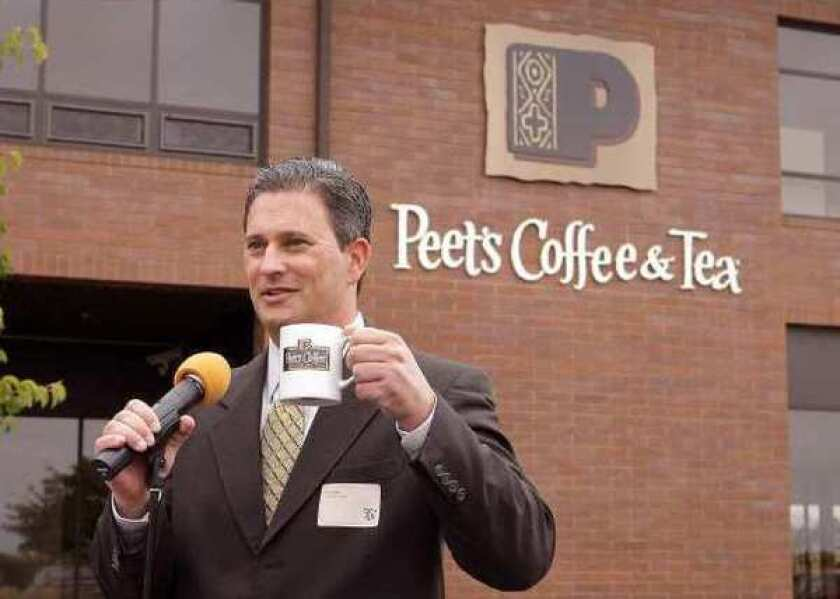 Pat O'Dea, chief executive of Peet's Coffee & Tea, toasts its first official roast in front of Peet's artisan roasting facility in Alameda in 2007.