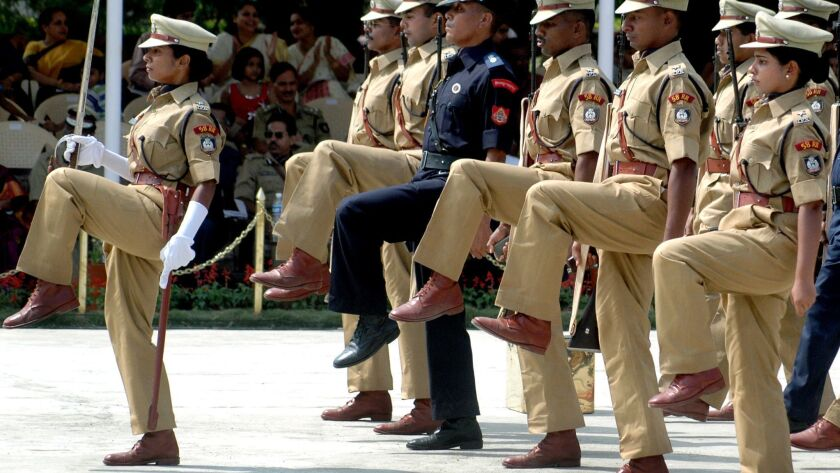 Indian police officers march in a ceremony at the national police academy.