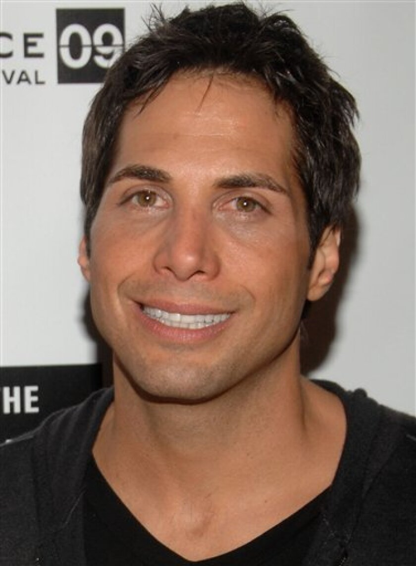 """This Jan. 18, 2009 file photo shows Joe Francis at the Sundance Film Festival in Park City, Utah. A federal judge says Francis can roam a little farther. Court records show U.S. District Judge S. James Otero ended the """"Girls Gone Wild"""" creator's house arrest on Wednesday, Feb. 11, 2009, but restricted his travel to seven counties in Southern California. (AP Photo/Peter Kramer, file)"""