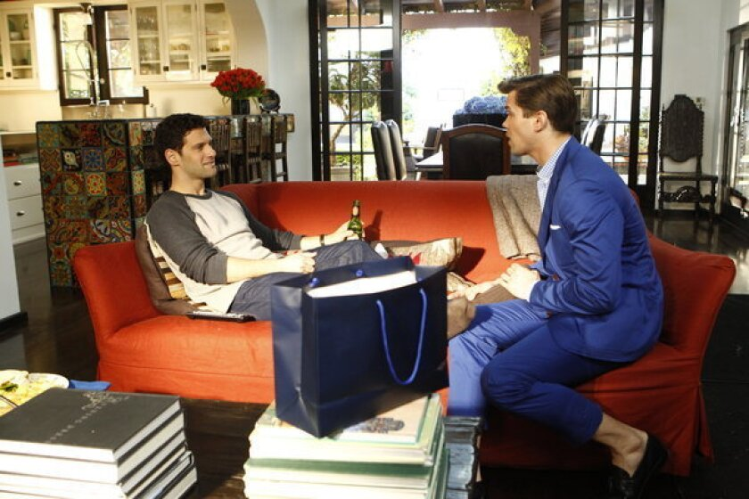 """The home of David (Justin Bartha), left, and Bryan (Andrew Rannells) on """"The New Normal' was inspired by a 1927 Spanish Colonial Revival house in Bel-Air once owned and restored by Diane Keaton."""
