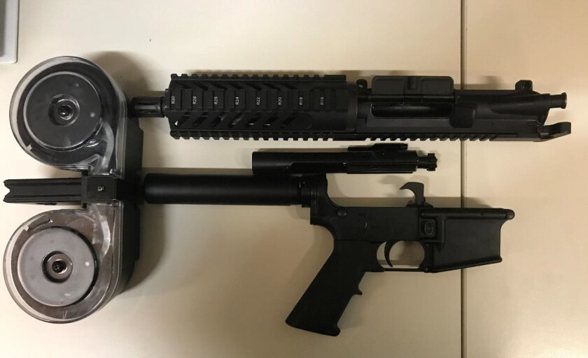 Officials said deputies found this modified AR-15 and high-capacity magazine following a Saturday night pursuit in Campo.