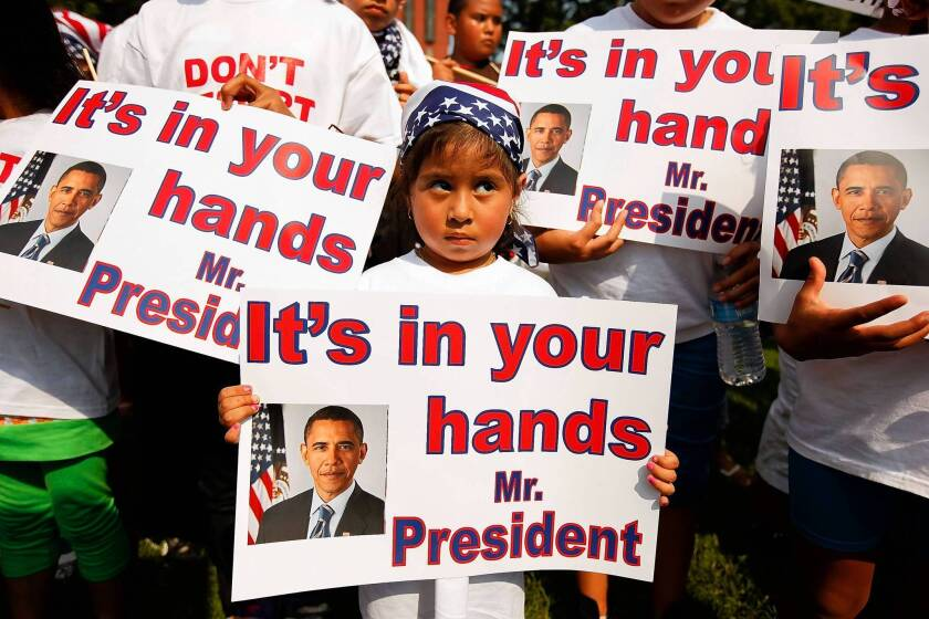 Children join a 2010 demonstration calling for changes in immigration policy. President Obama will call for immigration reform in an address Tuesday.