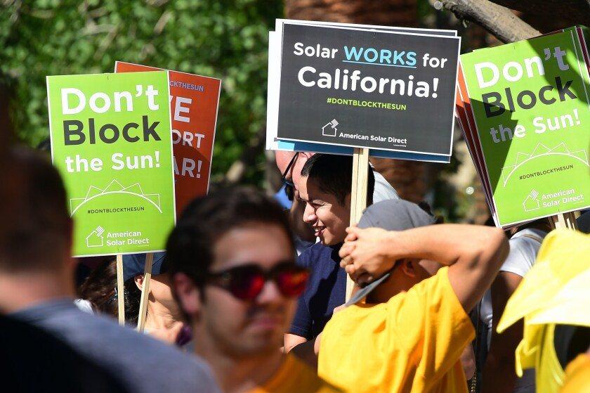 Solar proponents have been rallying to block changes to rooftop solar costs. On Tuesday, state regulators proposed new fees for solar customers.