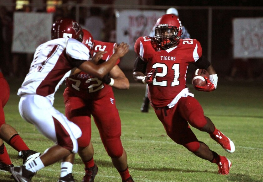 Imperial running back Royce Freeman runs for a 94-yard touchdown against Sweetwater on Friday night, one of his five TDs on the night.