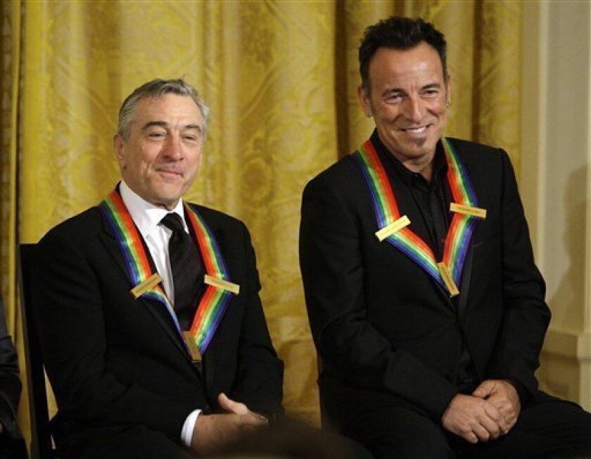 Kennedy Center honorees Bruce Springsteen, right, Robert De Niro sit in the East Room of the White House in Washington Sunday, Dec. 6, 2009. (AP Photo/Alex Brandon)