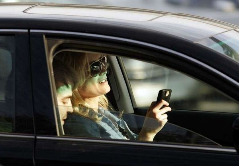 Just looking at your phone while driving is now a crime