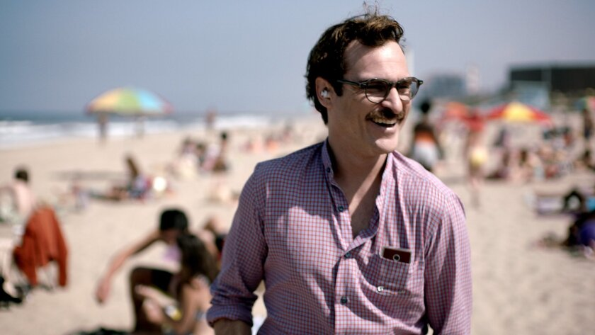 """FILE - This file image provided by Warner Bros. Pictures shows Joaquin Phoenix in a scene from """"Her."""" In """"Her,"""" Spike Jonze's futuristic exploration of a man's relationship with his computer, the filmmaker surveys human disjunction. (AP Photo/Warner Bros. Pictures, File)"""