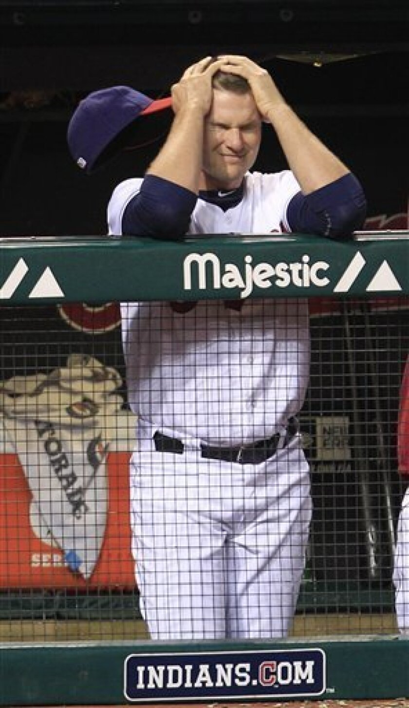 Cleveland Indians catcher Lou Marson reacts as he watches in the ninth inning of a baseball game against the Texas Rangers, Friday, Aug. 31, 2012, in Cleveland. The Rangers won 5-3. (AP Photo/Tony Dejak)