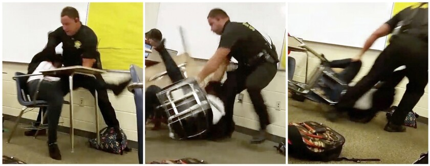 Senior Deputy Ben Fields forcibly removes a student after she refused to leave her high school math class in Columbia, S.C.