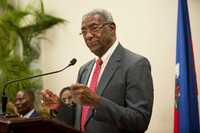 The president of the verification commission Francois Benoit speaks during a ceremony in the national palace, in Port-au-Prince, Haiti, Monday, May 30, 2016. The commission recommended throwing out the disputed results of last year's first-round presidential election because it appeared to be tainted by fraud. (AP Photo/Dieu Nalio Chery)