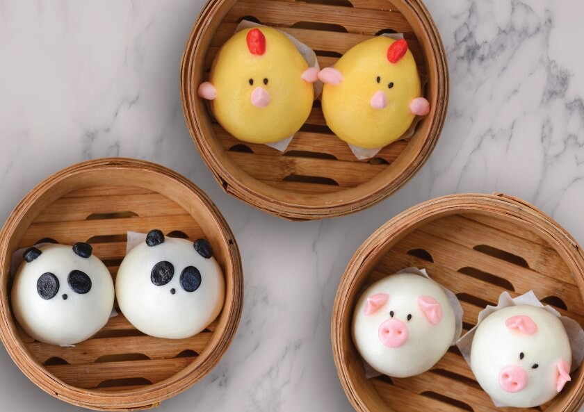 Harumama's crazy-cute character steamed buns (clockwise from top, chicken, caramelized onion and mozzarella; pork and caramelized onion; purple potato panda) are Instagram ideal.