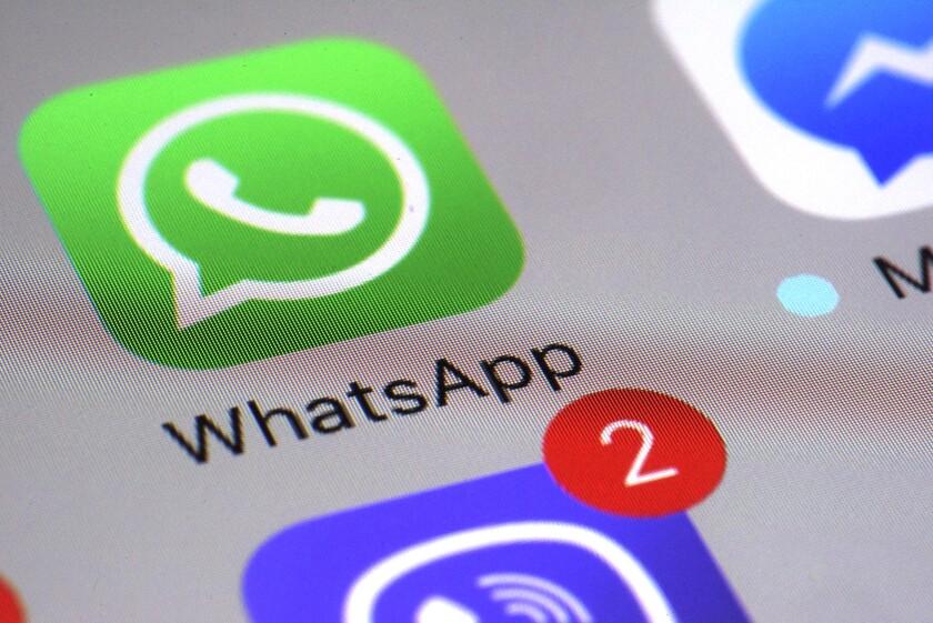 The WhatsApp icon on smartphone screen