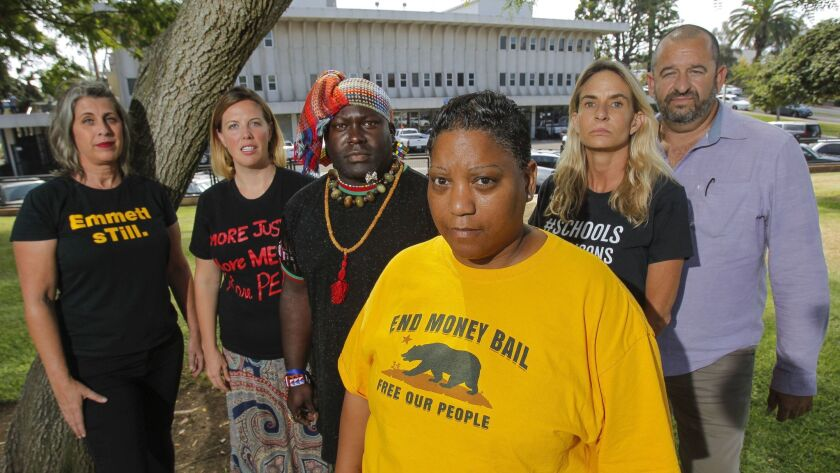 People leading the call for transparency surrounding the death of Earl McNeil while in the custody of National City police: from left, Aaryn Belfer, Blair Overstreet, Tenace, Tasha Williamson, Amie Zamudio, and Mark Lane.