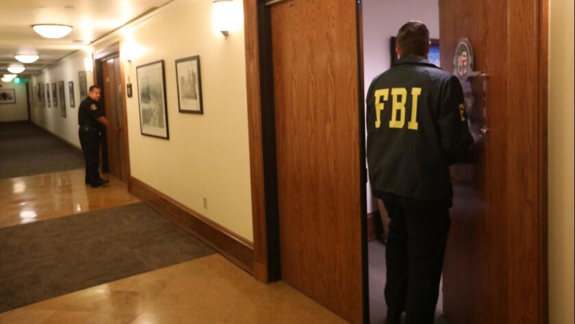 A FBI agent enters the office of City Councilman Jose Huizar at Los Angeles City Hall on November 7, 2018.