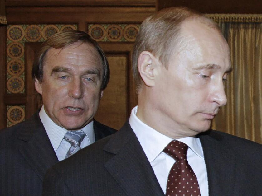 A 2009 photograph shows Russian cellist Sergei Roldugin, left, and his close friend Russian President Vladimir Putin.