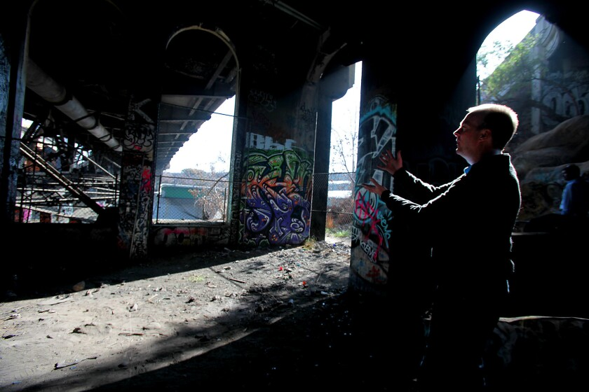 Preservationist and architect Kevin Mulcahy under the concrete and steel Riverside Drive Bridge on Jan. 10 in Los Angeles.