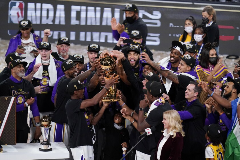 Jubilant Lakers circle around the championship trophy