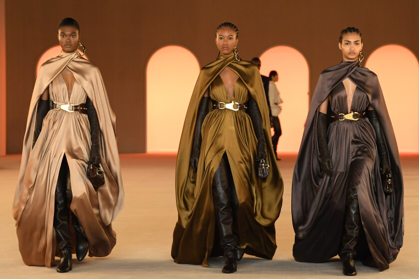 Capes on the Balmain AW20 runway