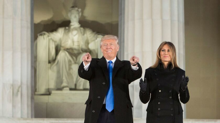 President-elect Donald J. Trump and incoming First Lady Melania Trump arrive at the 'Make America Great Again Welcome Celebration' concert at the Lincoln Memorial in Washington, D.C. on Jan. 19.