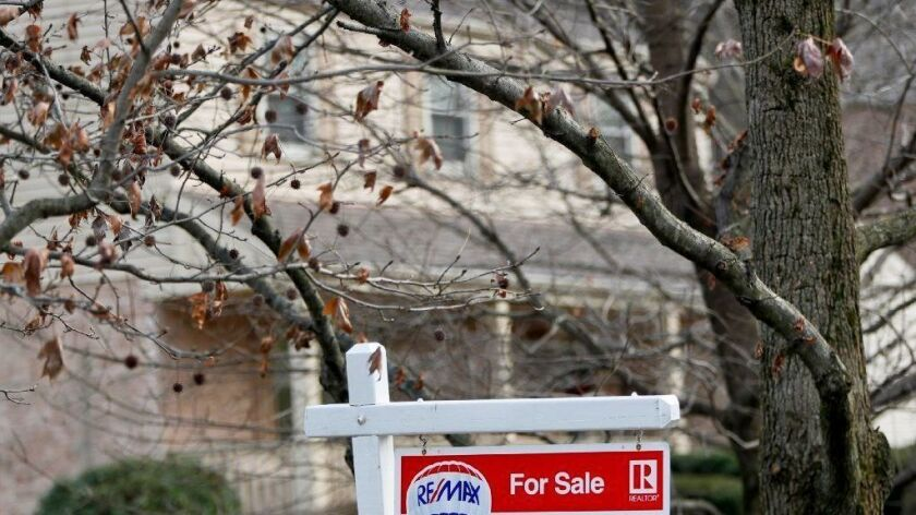 A sign marks a home for sale in Franklin Park, Pa., on Jan. 3, 2019. According to data released Jan. 17, the 30-year fixed-rate mortgage average was unchanged at 4.45 percent with an average 0.4 point.