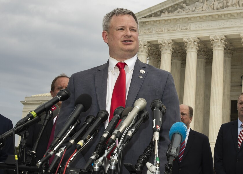 FILE- In this Sept. 9, 2019, file photo, South Dakota Attorney General Jason Ravnsborg, joined by a bipartisan group of state attorneys general, speaks to reporters in front of the U.S. Supreme Court in Washington. A judge overseeing the criminal trial of South Dakota Attorney General Jason Ravnsborg is ordering medical providers to turn over their health records for the pedestrian who was struck and killed by Ravnsborg last year. The order comes after Ravnsborg's defense alleged in court documents that Boever's Sept. 12 death may have been a suicide. (AP Photo/Manuel Balce Ceneta)