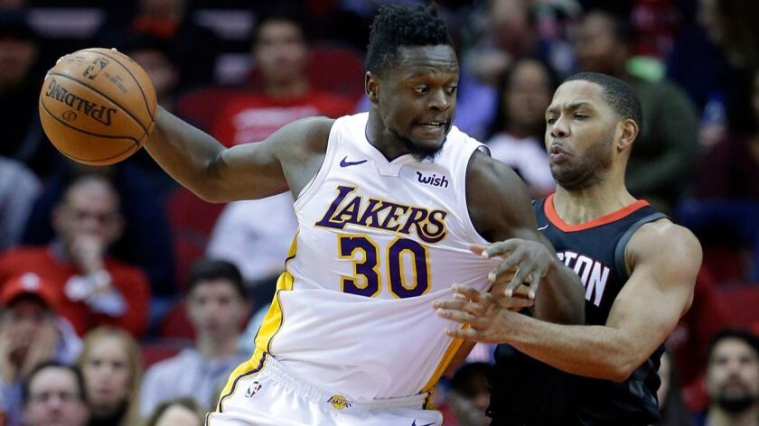 Lakers forward Julius Randle drives into Houston Rockets guard Eric Gordon in the second half Sunday.
