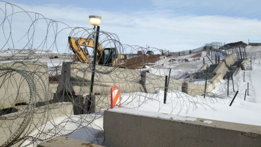 Razor wire and concrete barriers protect the Dakota Access pipeline drilling site near Cannon Ball, N.D.