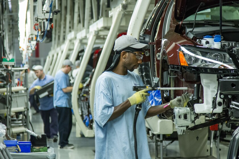Workers assemble Volkswagen Passat sedans at the German automaker's plant in Chattanooga, Tenn.