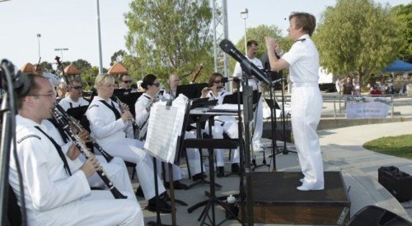 Lt. Diane Nichols leads the Navy Band Southwest at the Carmel Valley Recreation Center.