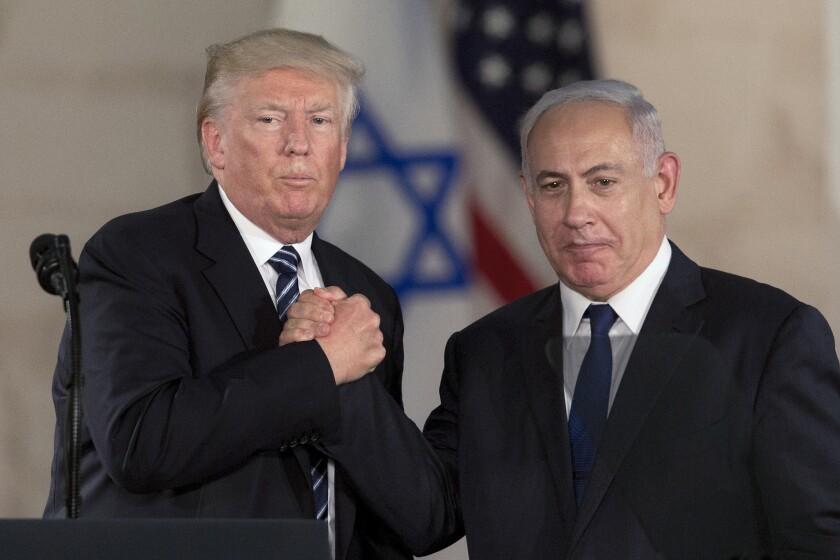 President Trump and Israeli Prime Minister Benjamin Netanyahu shake hands in May.