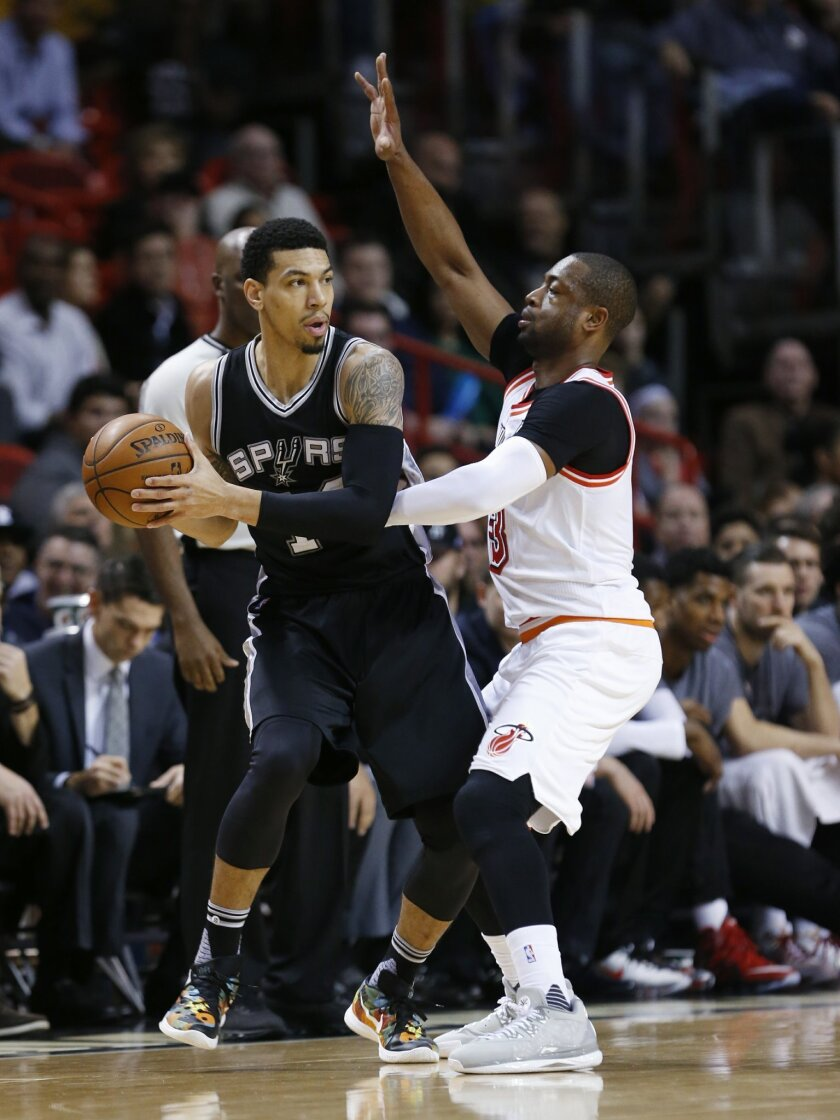 San Antonio Spurs guard Danny Green, left, looks for an open teammate past Miami Heat guard Dwyane Wade (3) during the first half of an NBA basketball game, Tuesday, Feb. 9, 2016, in Miami. (AP Photo/Wilfredo Lee)
