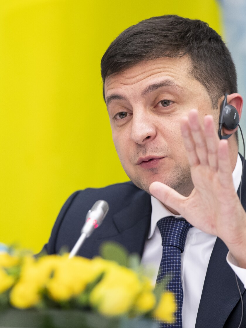 Ukraine's President Volodymyr Zelenskiy speaks during a news conference following his meeting with Lithuania's President Gitanas Nauseda at the Presidential Palace in Vilnius, Lithuania, Wednesday, Nov. 27, 2019. (AP Photo/Mindaugas Kulbis)