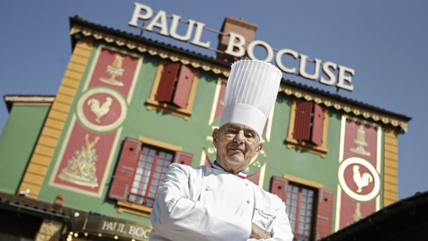 Chef Paul Bocuse stands outside his famed Michelin three-star restaurant, L'Auberge du Pont de Collonges, in Collonges-au-Mont-d'or in central France in March 2011.