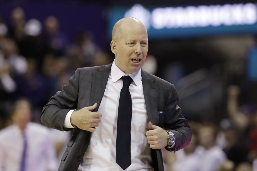 UCLA coach Mick Cronin walks along the bench during a game against Washington on Jan. 2.