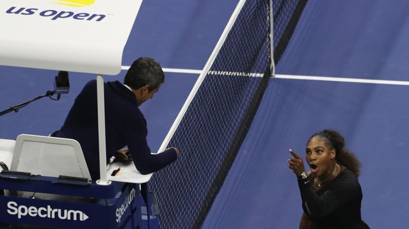Serena Williams confronts chair umpire Carlos Ramos during the U.S. Open women's tennis final Saturday in New York.