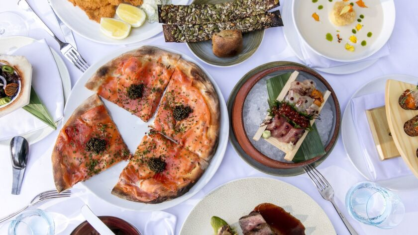 A spead at Spago, Wolfgang Puck's flagship restaurant in Beverly Hills, may include (clockwise from top left) veal Wiener schnitzel; bread plate; corn soup; spicy tuna tartare cones; Chirashi box; A-5 Wagyu steak; pizza with house-cured smoked salmon; and Spanish octopus.