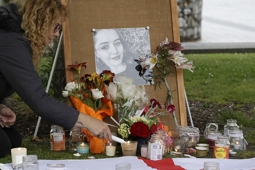 A photo of Grace Millane is displayed at a makeshift memorial for the slain British tourist in Christchurch, New Zealand, in 2018.