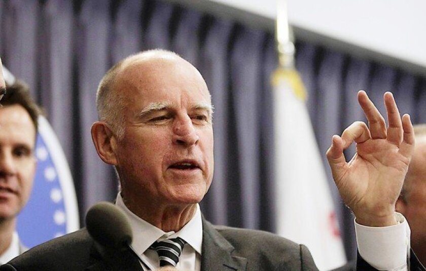 Gov. Jerry Brown signs bill to trim public pension costs